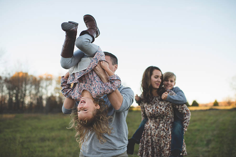 A family taking a stroll in a field in Southwest Missouri
