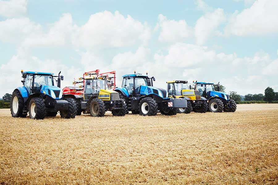 A row of tractors being set out to get ready for the work day